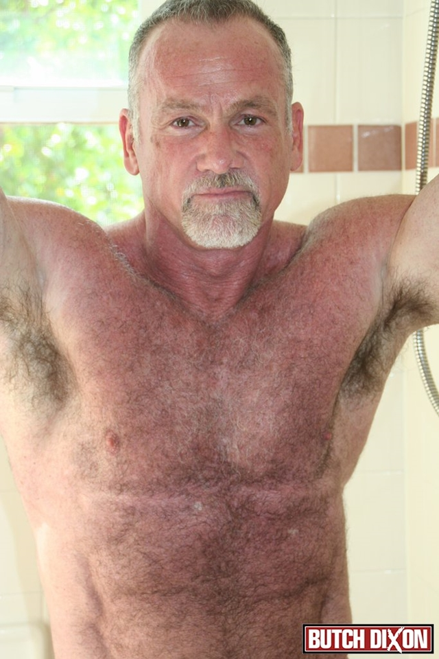 Butch-Dixon-silver-haired-hunk-older-mature-stud-Mickie-Collins-flexes-muscles-rubs-furry-tanned-skin-003-male-tube-red-tube-gallery-photo